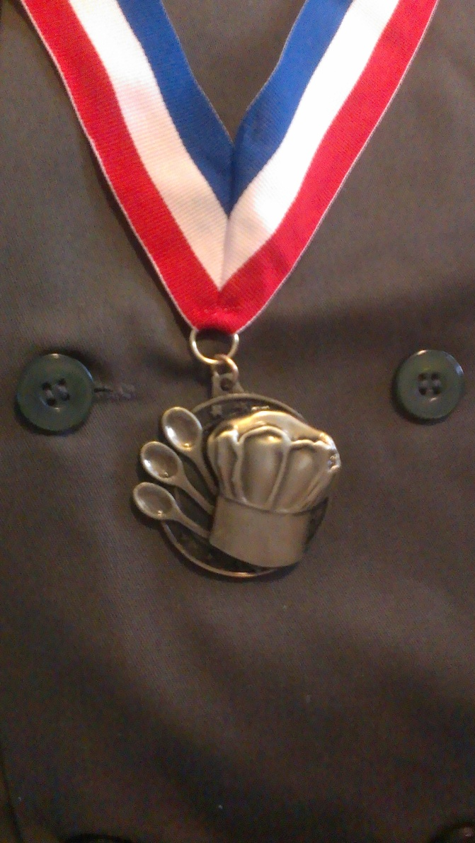 "The coveted and distinguished ""Bronze Chef"" medal. The General earned this honor for saute' techniques above the call of duty."